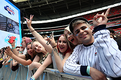 Fans on the front row of the crowd during Capital's Summertime Ball with Vodafone at Wembley Stadium, London. PRESS ASSOCIATION Photo. This summer's hottest artists performed live for 80,000 Capital listeners at Wembley Stadium at the UK's biggest summer party. Performers included Camila Cabello, Shawn Mendes, Rita Ora, Charlie Puth, Jess Glyne, Craig David, Anne-Marie, Rudimental, Sean Paul, Clean Bandit, James Arthur, Sigala, Years & Years, Jax Jones, Raye, Jonas Blue, Mabel, Stefflon Don, Yungen and G-Eazy. Picture date: Saturday June 9, 2018. Photo credit should read: Isabel Infantes/PA Wire