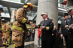 September 11, 2017 - Auckland, Auckland, New Zealand - Each firefighter is given a tag with the name of a firefighter lost in the line of duty before the climbing.  Firefighters from across the country climbs the Sky Tower's carrying the tag  to remember their fallen comrades  in 9/11 attack. The names of all 343 firefighters from the New York Fire Department lost in the September 11 World Trade Centre attacks and all 57 names of New Zealand firefighters lost while serving are read out, followed by a prayer before the climb. (Credit Image: © Shirley Kwok/Pacific Press via ZUMA Wire)