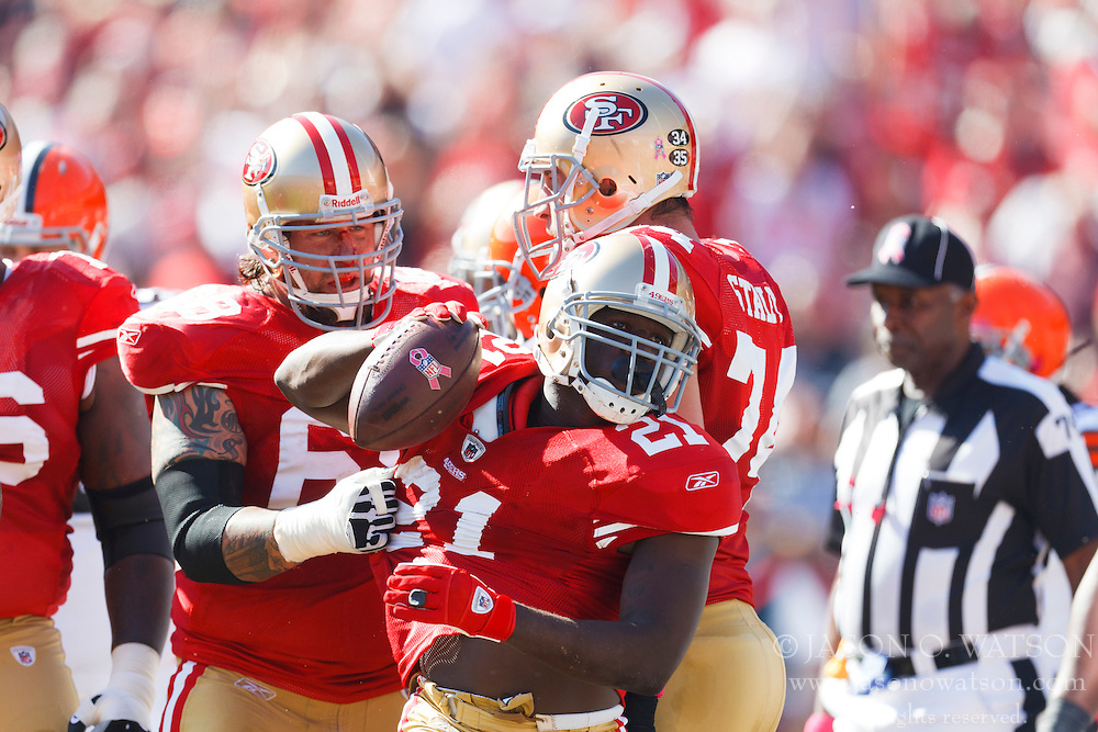 Oct 30, 2011; San Francisco, CA, USA; San Francisco 49ers running back Frank Gore (21) celebrates with teammates after scoring a touchdown during the first quarter at Candlestick Park. San Francisco defeated Cleveland 20-10. Mandatory Credit: Jason O. Watson-US PRESSWIRE