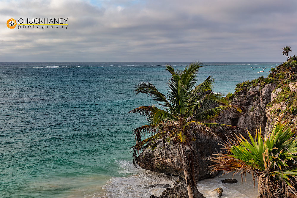Beach on the Carribean with fishing boats at the Archeological Zone of Tulum Mayan Port City Ruins in Tulum, Mexico