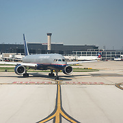 A United Airleines Boeing 757 taxiing out to the runway at O'hare Airport in Chicago, Illinois