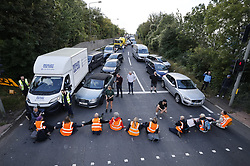 © Licensed to London News Pictures. 29/09/2021. Swanley, UK. Activists from the Insulate Britain climate change protest group block the road near to junction 3 of the M25 motorway near Swanley for the second time today. 11 members of the campaign group were detained at the same junction earlier today. This is the seventh time in just over two weeks that activists have disrupted traffic on London's orbital motorway despite the government being granted a temporary High Court Injucntion banning the group from protesting on the M25. 50 protesters who were detained after Monday's protest, on junction 14 of the M25 at Heathrow, were released. Photo credit: Peter Macdiarmid/LNP