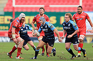 Tom James of Cardiff Blues © makes a break past Jake Ball of the Scarlets (l).   Guinness Pro12 rugby match, Scarlets  v Cardiff Blues at the Parc y Scarlets in Llanelli, West Wales on Saturday 2nd April 2016.<br /> pic by  Andrew Orchard, Andrew Orchard sports photography.