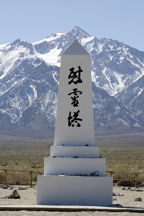 INDEPENDENCE, CA, March 19, 2008: The cemetery at Manzanar, one of ten remote War Relocation Centers in the United States where 11,000 Japanese were sent beginning in early 1942 during World War II, stands as the most preserved part of Manzanar. Fifteen of the 150 people who died at Manzanar were buried there with six burial sites remaining. Not trusting those with cultural ties to Japan who had bombed Pearl Harbor, the U.S. Government enclosed a  one square mile, remote area in the Eastern Sierra mountains with barbed wire and erected a mini city complete with churches, barracks, mess halls, hospitals and even baseball fields. A cemetery and graves still adorn the property which is now a National Historic Site.