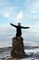 Posing by the cairn at Rundfjellet, Budal, after having cimbed the mountain