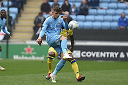 Coventry City midfielder Tom Bayliss (20) on defensive duties during the EFL Sky Bet League 1 match between Coventry City and Bristol Rovers at the Ricoh Arena, Coventry, England on 7 April 2019.
