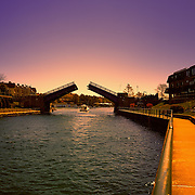 """Evening in Charlevoix""<br /> Enjoy a beautiful sunset walk in Charlevoix Michigan, watching the drawbridge open!"