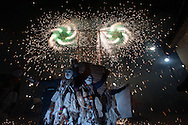 """Feast of """"Mamacha del Carmen"""" of Paucartambo. At the end of the first day of celebration some groups of dancers, as Qapaq Qolla, enjoy the """"Qonoy"""", a game made with flames and fireworks."""