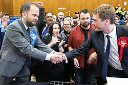 © Licensed to London News Pictures . 13/12/2019. Bury, UK. Conservatives celebrate their narrow win in the Bury North count after Labour candidate JAMES FRITH (r) concedes to JAMES DALY (l) following a recount , at the count for seats in the constituencies of Bury North and Bury South in the 2019 UK General Election , at Castle Leisure Centre in Bury . Photo credit: Joel Goodman/LNP