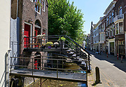 Canal with small bridges in dutch city Gouda, Netherlands