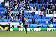 Cardiff city manager Ole Gunnar Solskjaer removes his jacket as he walks off at end of match. Barclays Premier league match, Cardiff city  v Stoke city at the Cardiff city stadium in Cardiff, South Wales on Saturday 19th April 2014. pic by Andrew Orchard, Andrew Orchard sports photography,