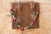 India, Rajasthan, Jodhpur, Mehrangarh fort The handprints of the wives of the city elders who were imprinted before they killed themselves when the city was conquered. Praying to them brings good luck