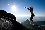Warren Gans from Cape Town becomes the first person to Slackline across the 150 metre wide Union Ravine on Table Mountain over 1,000 metres above the sea below. Picture by Greg Beadle