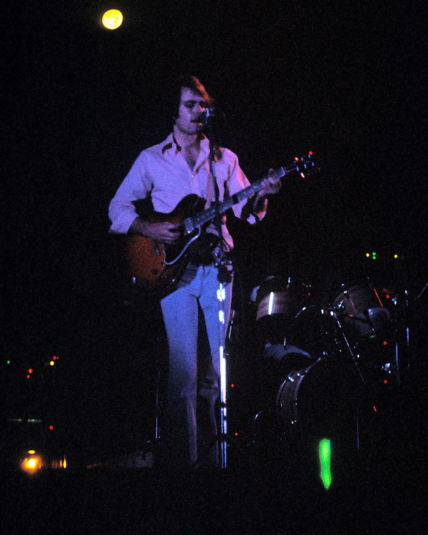 Bob Weir performing with The Grateful Dead Live at Dillon Stadium, Hartford, CT 31 July 1974. Featuring the Wall of Sound. Singing and playing with back-light stage lighting and blue wash.