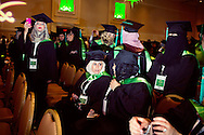 Samar Almadani of Jeddah, Saudi Arabia speaks with another Saudi National and recent masters degree recipient during the Royal Embassy of Saudi Arabia Cultural Mission's Graduation Ceremony at the Gaylord Hotel, National Harbor, MD.  The graduation ceremony is part of the higher education program initiated in the wake of September 11th to improve relations between the U.S. and Saudi Arabia as well as train the nation's next generation of leaders.  Despite exposure to Western mores, many of the graduates in attendance expressed a desire to move back to Saudi Arabia and maintain their traditional values.<br /> (photo by Melissa Golden)