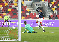 Middlesbrough's Chuba Akpom sees his close range shot saved by Brentford's Luke Daniels<br /> <br /> Photographer Rob Newell/CameraSport<br /> <br /> The Emirates FA Cup Third Round - Brentford v Middlesbrough - Saturday 9th January 2021 - Brentford Community Stadium - Brentford<br />  <br /> World Copyright © 2021 CameraSport. All rights reserved. 43 Linden Ave. Countesthorpe. Leicester. England. LE8 5PG - Tel: +44 (0) 116 277 4147 - admin@camerasport.com - www.camerasport.com