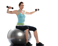 one caucasian woman exercising workout weigth training sitting on fitness swiss ball full length isolated on white background