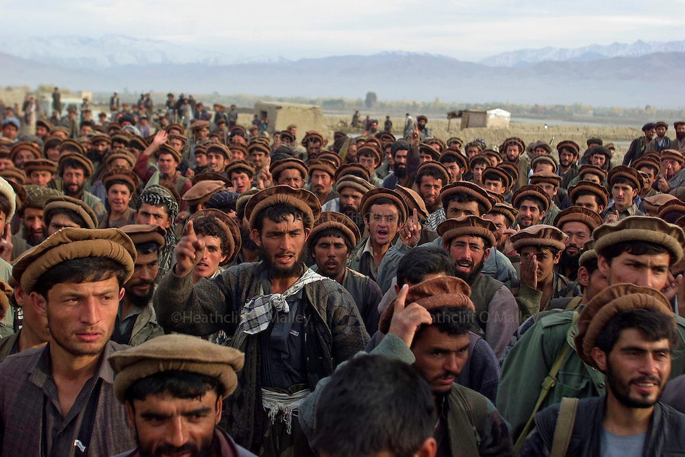 Northern Alliance soldiers on the outskirts of Taloqan .