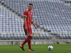 MUNICH, Aug. 8, 2017  Bayern Munich's Niklas Suele reacts prior to taking team photos at Allianz Arena in Munich, Germany, on Aug. 8, 2017. Players and coaches of Bayern Munich took team photos for the upcoming German Bundelisga season at Allianz Arena on Tuesday. (Credit Image: © Philippe Ruiz/Xinhua via ZUMA Wire)