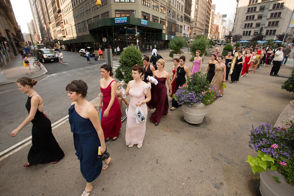 Dancers on their way to the Flatiron Biulding.