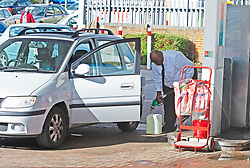 © Licensed to London News Pictures 29/09/2021.<br /> Swanley, UK, This man is also filling up a very large Jerry can, good job he is next to fire extinguishers. The petrol shortage continues today with motorists queuing for hours at this Co-op petrol station in Swanley, Kent. This station only had unleaded left at two pumps at 10.30am, staff said the station will be empty within two hours. Photo credit:Grant Falvey/LNP