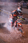 #171 David Gassin from Ione, CA navigates the treacherous water pit at the 2007 Maxxis AMA Endurocross at the Lazy E Arena in Guthrie, Oklahoma.  Event was won by David Knight #101 on KTM