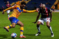 James Perch of Mansfield Town looks to get past Alex John-Baptiste of Bolton Wanderers - Mandatory by-line: Ryan Crockett/JMP - 17/02/2021 - FOOTBALL - One Call Stadium - Mansfield, England - Mansfield Town v Bolton Wanderers - Sky Bet League Two