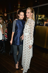 Left to right, SARAH ANN MACKLIN and POPPY DELEVINGNE at the Launch Of Osman Yousefzada's 'The Collective' 4th edition with special guest collaborator Poppy Delevingne held in the Rumpus Room at The Mondrian Hotel, 19 Upper Ground, London SE1 on 24th November 2014, sponsored by Storm models and Beluga vodka.