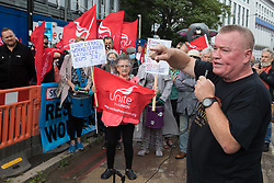 Steve Dillon, Regional Coordinating Officer of Unite Scotland, addresses Unite the union members protesting outside the Euston construction site for the HS2 high-speed rail link regarding trade union access to construction workers building tunnel sections for the project on 6th August 2021 in London, United Kingdom. Unite claims that HS2's joint venture contractor SCS, formed by Skanska, Costain and Strabag, has been hindering 'meaningful' trade union access to HS2 construction workers in contravention of the HS2 agreement.