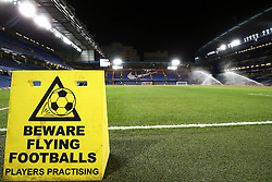 "Beware of Flying Footballs sign pitch side prior to the Premier League match at Stamford Bridge, London. PRESS ASSOCIATION Photo. Picture date: Wednesday January 31, 2018. See PA story SOCCER Chelsea. Photo credit should read: Nigel French/PA Wire. RESTRICTIONS: EDITORIAL USE ONLY No use with unauthorised audio, video, data, fixture lists, club/league logos or ""live"" services. Online in-match use limited to 75 images, no video emulation. No use in betting, games or single club/league/player publications."