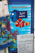 Pixar movie Finding Nemo Clownfishes printed on to tourist towels in a shop side street window in Male, Maldives.