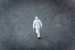 A dock worker at Port Everglades wears protective clothing due to the Coronavirus pandemic.