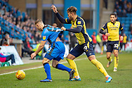 Gillingham FC defender Barry Fuller (12) and Scunthorpe United forward Kyle Wootton (29) during the EFL Sky Bet League 1 match between Gillingham and Scunthorpe United at the MEMS Priestfield Stadium, Gillingham, England on 16 February 2019.