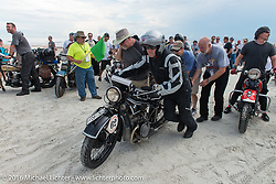 Scott Blaylock and his 1928 BMW R62 pass through the start on the sands of Daytona Beach at the beginning of stage 1 of the Motorcycle Cannonball Cross-Country Endurance Run, which on this day ran from Daytona Beach to Lake City, FL., USA. Friday, September 5, 2014.  Photography ©2014 Michael Lichter.