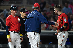 September 1, 2017 - Minneapolis, MN, USA - Minnesota Twins manager Paul Molitor separates second baseman Brian Dozier, right, from home plate umpire Mark Wegner after Dozier became irate following a called third strike on Dozier to end the seventh inning against the Kansas City Royals on Friday, Sept. 1, 2017, at Target Field in Minneapolis. The Royals won, 7-6. (Credit Image: © Aaron Lavinsky/TNS via ZUMA Wire)