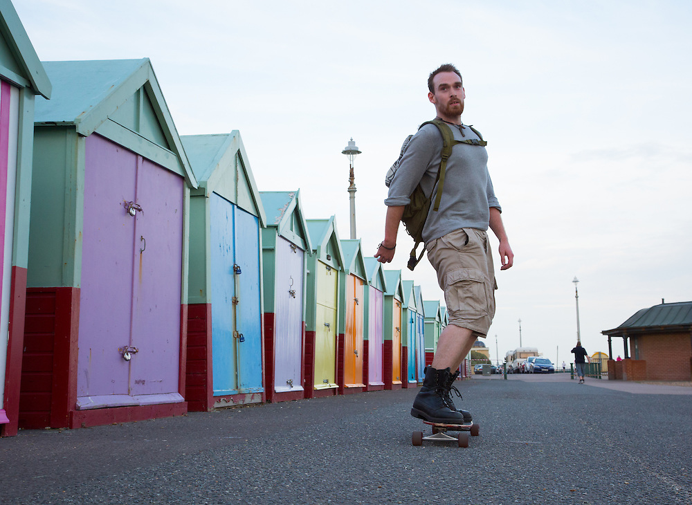 """Alex commutes two miles to work in the summer on a longboard. """"It's nice to be active and in the elements, rather than squashed in a bus. It's also soothing for the soul,"""" he adds. I need no convincing, as I watch his frame rapidly disappearing past the iconic Hove beach huts."""