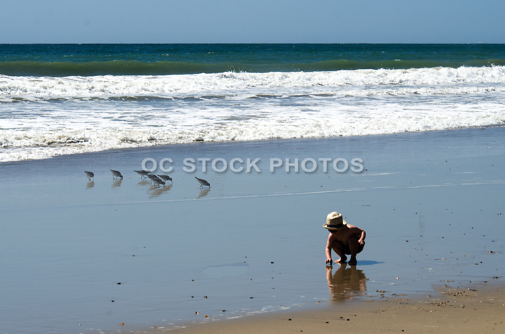 Young Boy Playing in the Sand on the Beach in Laguna
