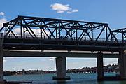 Cyclists pass along the  Iron Cove Bridge, Sydney, Australia,