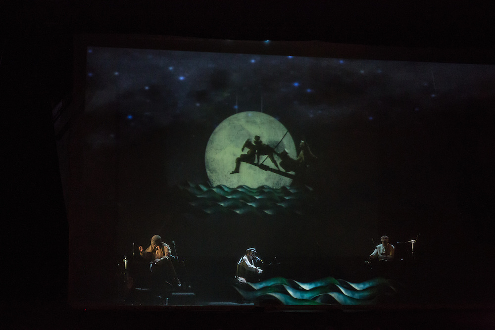 As the Tiger Lillies perform, the Ancient Mariner, seen projected on a scrim behind them, is about to have the albatross hung around his neck.