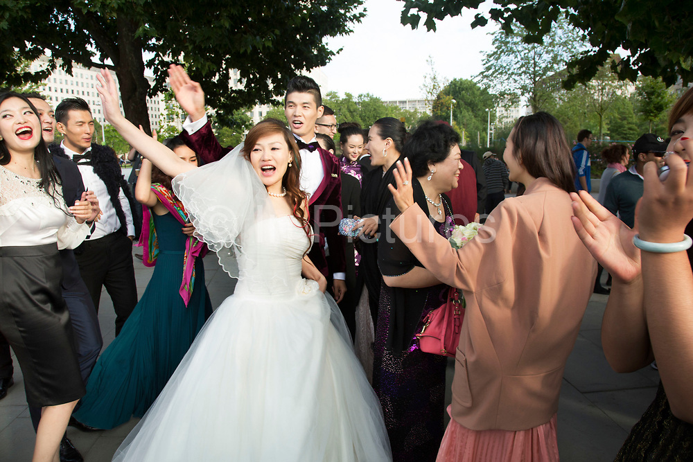 Chinese wedding party of friends and relatives descend upon the South Bank. The happy couple who were from Beijing had only been in London for one day, having travelled to the UK just to get married. Waving goodbye to the Southbank.