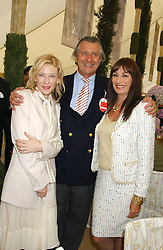 Left to right, CATE BLANCHETT, ARNAUD BAMBERGER and ANJELICA HUSTON at the 2005 Cartier International Polo between England & Australia held at Guards Polo Club, Smith's Lawn, Windsor Great Park, Berkshire on 24th July 2005.<br />