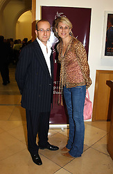 PAUL McKENNA and MISS CLARE STAPLES at a party to celebrate the publication of 'You Are Here' by Rory Bremner, Juhn Bird and John Fortune held at the National Portrait Gallery, St.Martin's Place, London on 1st November 2004.<br /><br />NON EXCLUSIVE - WORLD RIGHTS