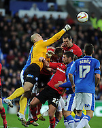 Peterborough goalkeeper Robert Olejnik punches clear from a Cardiff corner. NPower championship, Cardiff city v Peterborough Utd at the Cardiff city stadium in Cardiff, South Wales on Sat 15th Dec 2012. pic by Andrew Orchard, Andrew Orchard sports photography,