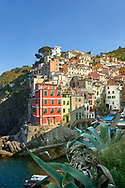 Fishing village and harbour of Riomaggiore at sunrise, Cinque Terre National Park, Liguria, Italy .<br /> <br /> Visit our ITALY HISTORIC PLACES PHOTO COLLECTION for more   photos of Italy to download or buy as prints https://funkystock.photoshelter.com/gallery-collection/2b-Pictures-Images-of-Italy-Photos-of-Italian-Historic-Landmark-Sites/C0000qxA2zGFjd_k