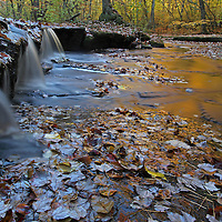 Scenic waterfall photos of this stunningly beautiful Rhode Island fall foliage and waterfall long exposure photography scenery at Stepstone Falls are available as museum quality photography prints, canvas prints, acrylic prints or metal prints. Prints may be framed and matted to the individual liking and decorating needs at<br />