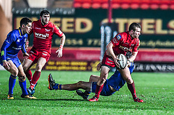 Scarlets' Jonathan Evans is tackled by Leinster's Ross Byrne<br /> <br /> Photographer Craig Thomas/Replay Images<br /> <br /> Guinness PRO14 Round 17 - Scarlets v Leinster - Friday 9th March 2018 - Parc Y Scarlets - Llanelli<br /> <br /> World Copyright © Replay Images . All rights reserved. info@replayimages.co.uk - http://replayimages.co.uk