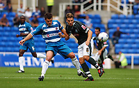 Photo: Alan Crowhurst.<br /> Reading v Plymouth Argyle. Coca Cola Championship.<br /> 06/08/2005. Readings Graeme Murty (l) challenges Akos Buzsaky for the ball.