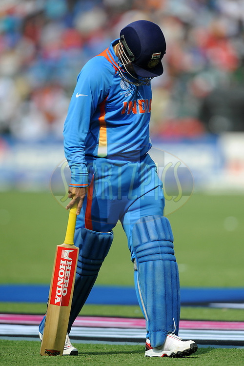 Virender Sehwag of India walks back after getting out during the ICC Cricket World Cup match between India and England held at the M Chinnaswamy Stadium in Bengaluru, Bangalore, Karnataka, India on the 27th February 2011..Photo by Pal Pillai/BCCI/SPORTZPICS