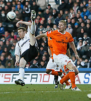 Photo: Steve Bond/Richard Lane Photography. Derby County v Blackpool. Coca-Cola Championship. 26/12/2009. Stephen Pearson (L) clears with an overhead kick above Keith Southern (R)