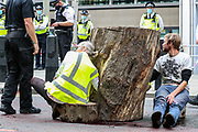 Extinction Rebellion activists glued themselves outside Home Office in Marsham Street in central London on Wednesday, Sept 2, 2020. Environmental activist group XR enters its 2nd day of climate change demonstrations, which they began on the first week of September. (VX Photo/ Vudi Xhymshiti)